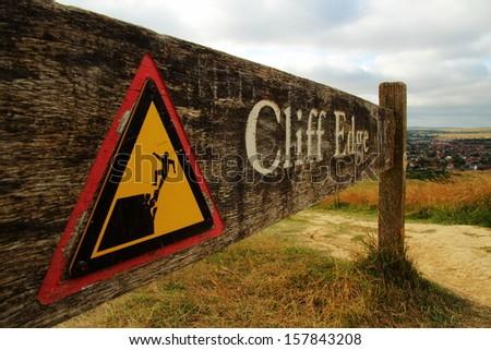 Cliff edge warning sign - stock photo