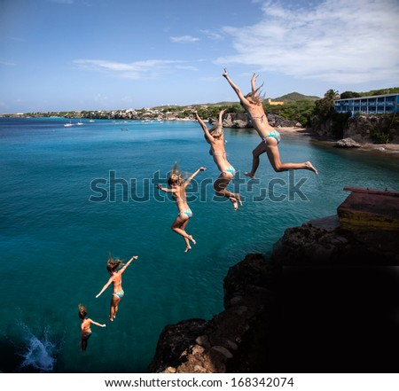 Cliff jumper at Forti Beach Westpunt the West end of Curacao Caribbean - stock photo