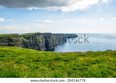 Cliff's of Moher, Ireland wit blue sky - stock photo