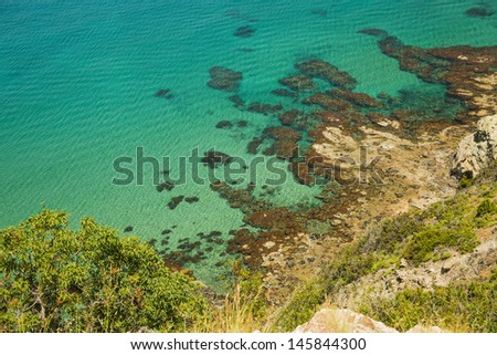 Cliff to the sea with crystal clear water
