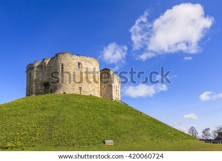 Clifford's Tower in York, England,is the remains of a 13th century castle and commands a view of the surrounding countryside from its hill top position.