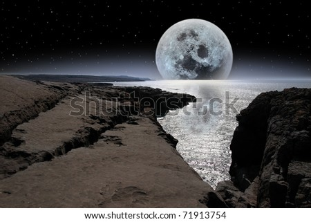 cliffs and coastline of the burren in county clare ireland with bright moon in night sky - stock photo