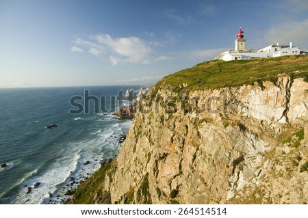 "Cliffs and lighthouse of Cabo da Roca on the Atlantic Ocean in Sintra, Portugal, the westernmost point on the continent of Europe, ""where the land ends and the sea begins"". - stock photo"