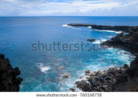 Cliffs and pacific ocean landscape vue from Ana Kakenga cave in Easter island, Chile