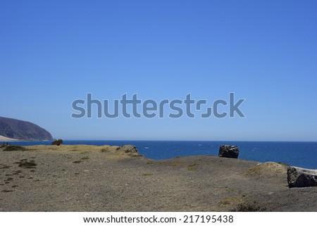 Cliffs and rocks along PCH-1 in Ventura County near Point Mugu, Southern California - stock photo