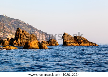 Cliffs and Rocks at Sunset in Cinque Terre, Italy - stock photo