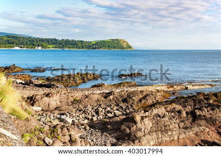 Cliffs and rocks on the Coast of Antrim County in Northern Ireland, UK. - stock photo