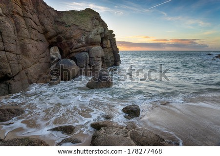 Cliffs and sea caves at Porthgwarra Cove on the Lands End Peninsula near Penzance - stock photo