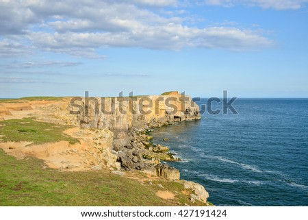 Cliffs at St Govan's Head on the Pembrokeshire Coast National Park in Wales - stock photo