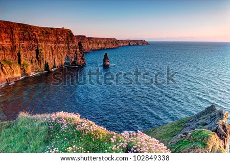 Cliffs of Moher in Ireland at sunset. - stock photo