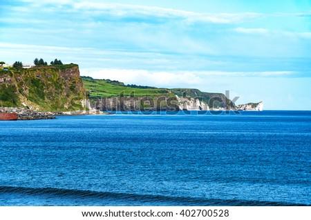 Cliffs on Northern Coast of Antrim County in Northern Ireland. - stock photo