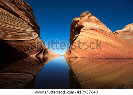 cliffs reflecting in the water surface in the wave arizona  - stock photo
