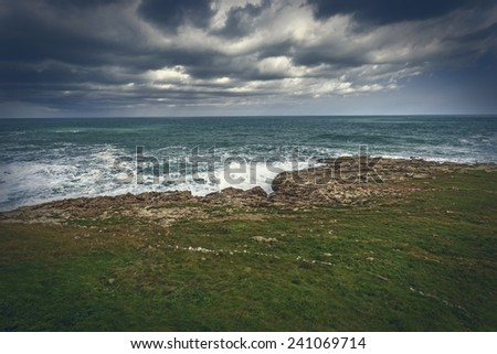 Cliffs with sea and clouds background. - stock photo