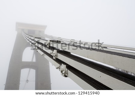 Clifton Suspension bridge cables in the early morning mist - stock photo