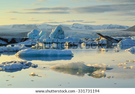 Climate change concept: ice moving with the tide during a summer sunset at Jokulsarlon lagoon - Iceland. - stock photo