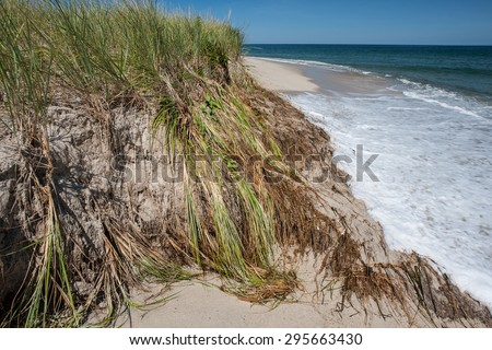 Climate change is causing sea levels to rise in many places including Cape Cod, Massachusetts. Higher tides are causing major erosion all over the peninsula, especially along the beaches. - stock photo