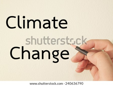 climate change text write on wall  - stock photo