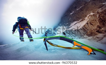 climber and a green rope - stock photo