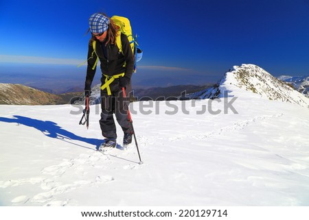 Climber ascending with an ice axe in winter