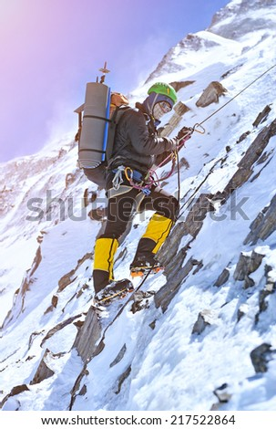 Climber going to the summit - stock photo