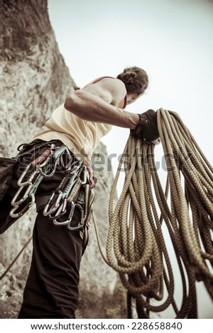 climber holding a rope before climbing. - stock photo