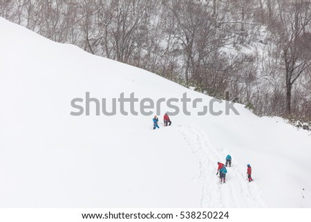 Climber in a snow mountain and storm
