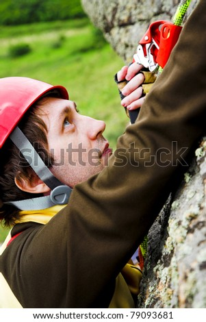 climber in red helmet on the rock
