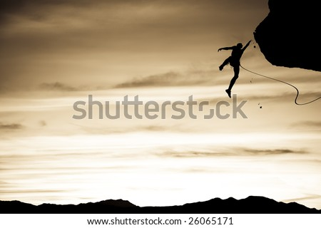 Climber in trouble clinging to a cliff for dear life in The Sierra Nevada Mountains, California. - stock photo
