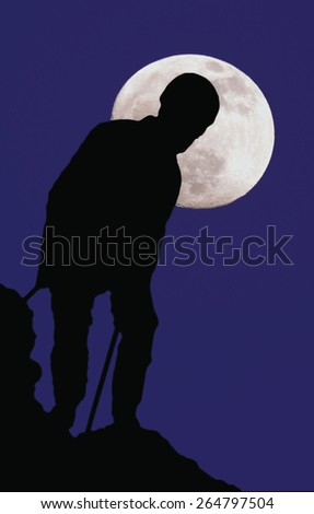 climber on a background of the moon - stock photo