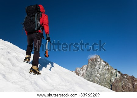 Climber on a snowy ridge, Grivola, west italian alps, Europe. Horizontal frame.