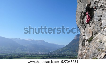 climber on a steep route in the Swiss Alps