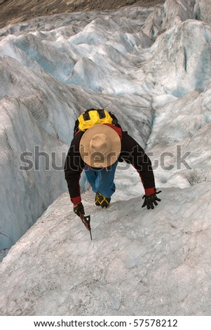 Climber on ice of glacier.Norwegian glacier.Nigardsbreen glacier. - stock photo