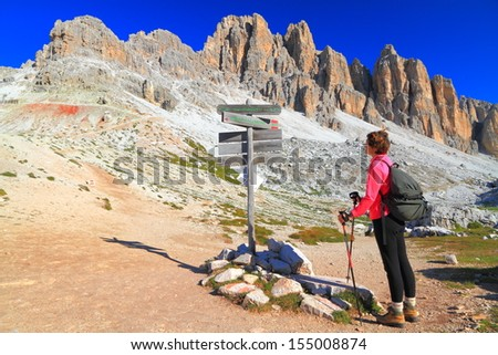 Climber on mountain crossroads near Travenanzes saddle, Dolomite Alps, Italy - stock photo