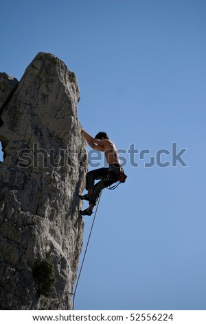 climber on rock - stock photo