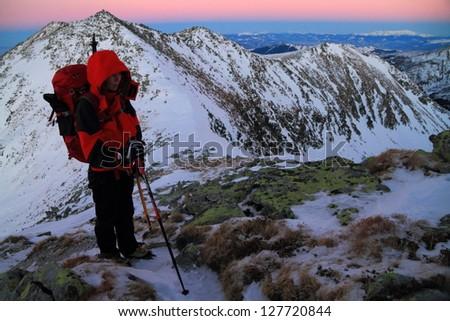 Climber on the mountain at dusk, Retezat mountains, Romania - stock photo