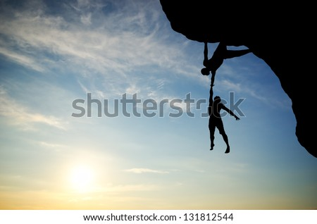 climber on the mountain holding another