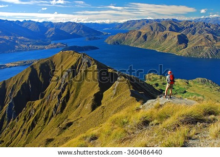 Climber on the Wanaka lake, Mount Aspiring National Park, Otago Region, South Island, New Zealand - stock photo