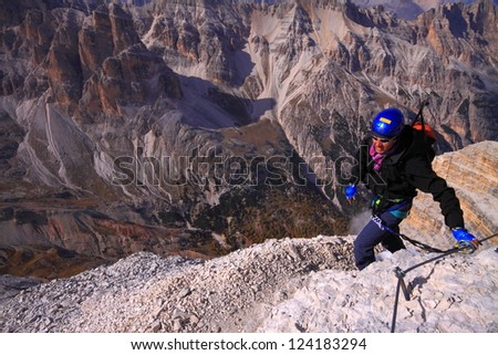 Climber on top section of via ferrata Lipella, Tofana di Rozes, Italy - stock photo