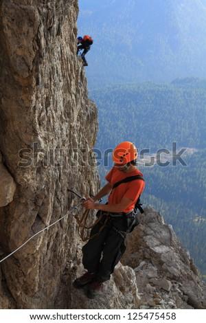 Climber on via ferrata Olivieri, Dolomite Alps, Italy - stock photo