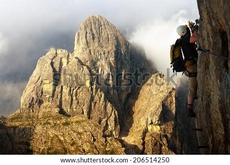 climber on via ferrata or klettersteig in Italy or Austria dolomit - Dolomiti di Sesto or Sextener Dolomiten - stock photo
