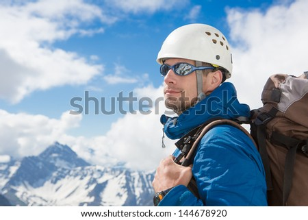 Climber portrait in winter mountains  - stock photo