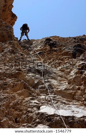 Climber rapelling down - stock photo