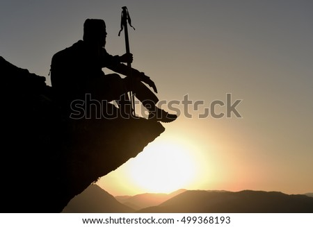 climber sitting on the rocky summit