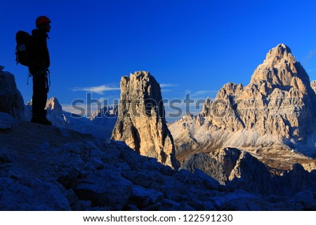 Climber watching the outstanding mountain view, Cadini di Misurina, Dolomite Alps, Italy - stock photo