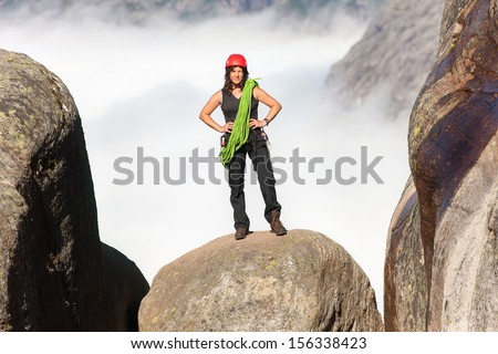 climber with a rope on the rock top