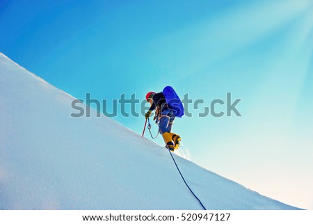 Climber with backpacks reaches the summit of mountain peak. Success, freedom and happiness, achievement in mountains. Active sport concept.