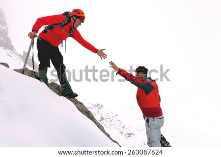 climbers and a helping hand - stock photo