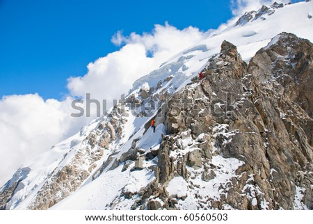climbers in mountains - stock photo