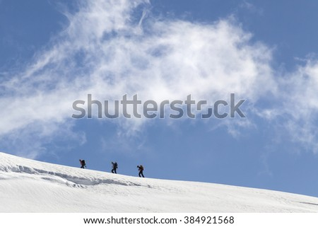 Climbers on the Jungfraujoch mountain above Lauterbrunnen, Switzerland, the highest point in Europe - stock photo