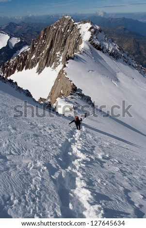 Climbers reaching the summit at Alps